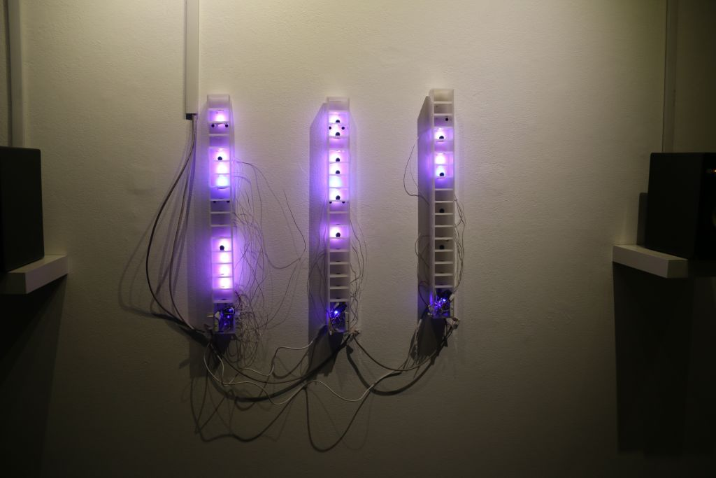 three plexiglass columns with LEDs